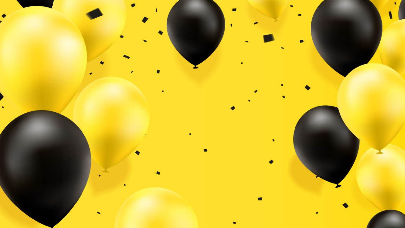 sorte og gule ballonger på gul bakgrunn. Sort konfetti flagrer i lufta