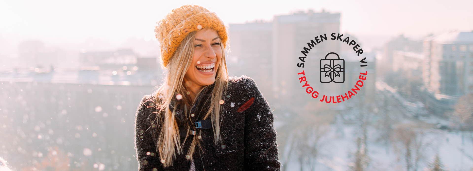 Kvinne som smiler og det står Trygg Handel
