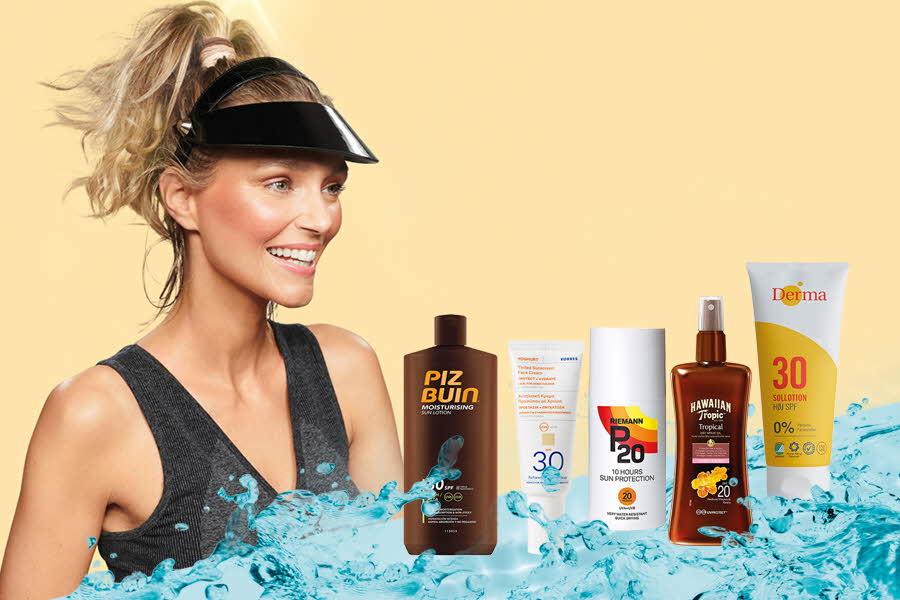 Sporty dame står ved siden av solpleie-produkter